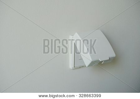 White Power Outlet Cover, Plug Housing Or Plug Socket With Waterproof Cover On White Wall .electric