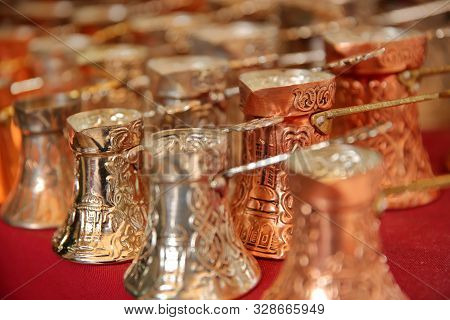 Close-up On Traditional Bosnian Copper Coffee Pots In Kazandziluk Street, The Famous Coppersmith Tra
