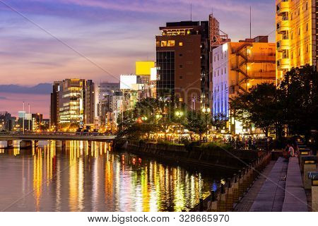 Fukuoka old town along naka river at Nakasukawabata sunset twilight. This area is favorite for tourist for Fukuoka Yatai, street Food stall,  for hangout at night.