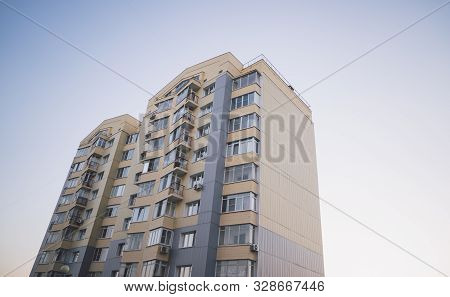 Modern Apartment Buildings On A Sunny Day With A Blue Sky. Facade Of A Modern Apartment Building. Re