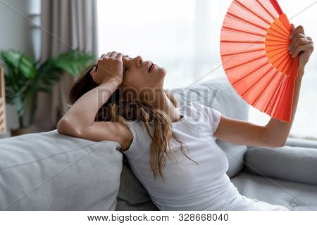 Exhausted Girl Using Paper Waver, Suffering From Hot Summer Weather.