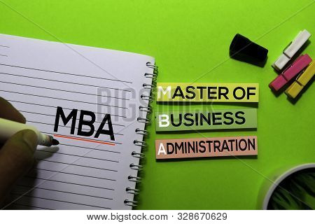 Mba. Master Of Business Administration Acronym On Sticky Notes. Office Desk Background