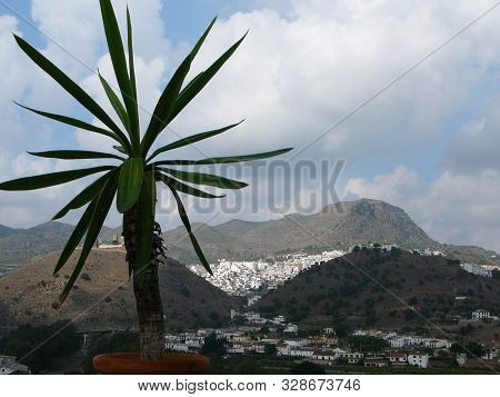 View Over White Village Of Alora, Andalusia Across Valley