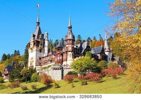 Peles Castle, Romania. Beautiful famous royal castle and ornamental garden in Sinaia landmark of Carpathian Mountains in Europe poster
