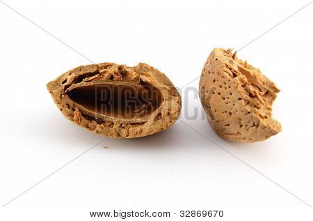 Cracked shell of almond nut on white background poster