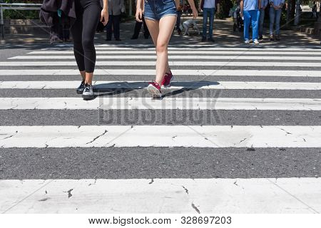Pedestrian Crossing City Downtown Women Walk In Motion On Road. Many Legs, Feet And Shoes From Diffe