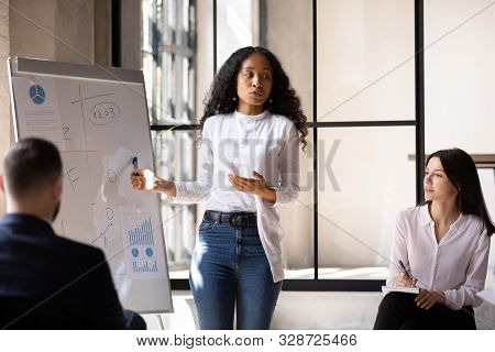 Confident African Conference Conductor Give Flip Chart Presentation At Training