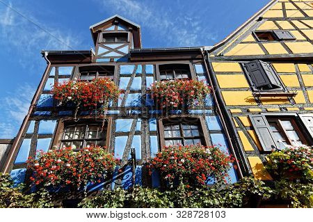Riquewihr, France, October 13, 2019 : Old Half-timbered House. Popular Tourist Attraction For Its Hi