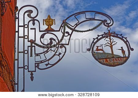 Riquewihr, France, October 13, 2019 : Old Winery Sign. The Village Is A Popular Tourist Attraction F