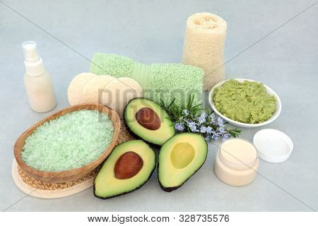 Vegan beauty treatment for skincare with avocado face mask, rosemary herb, exfoliation mineral salts, moisturising cream,  lotion & cleansing products.