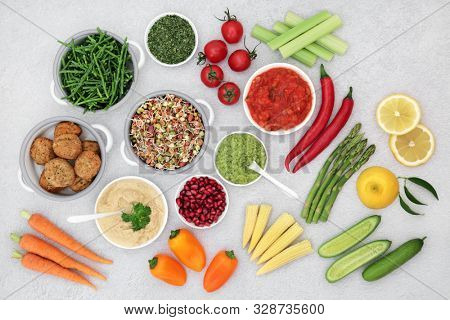 Vegan health food concept with plant based foods of fruit, vegetables, dips and meat substitutes. High in vitamins, minerals, anthocyanins, antioxidants, protein, fibre and smart carbs. Flat lay.