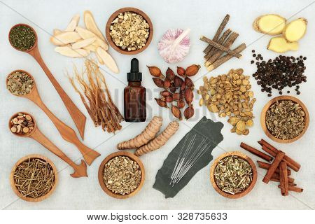 Alternative and chinese herbal medicine to treat asthma, COPD and respiratory diseases with herbs and spice selection and acupuncture needles. Flat lay.