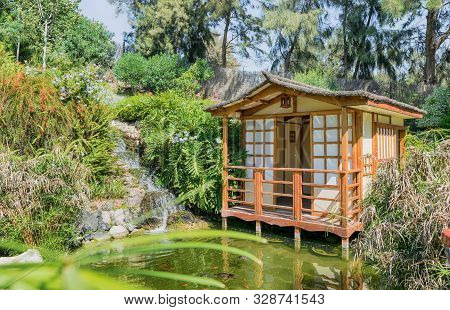 House In A Beautiful Japanese Garden. Japanese Architecture.