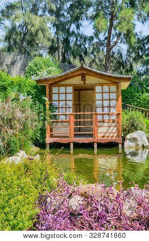 Japanese House In Japanese Garden. Colorful Nature.