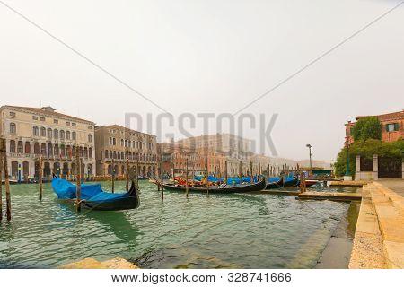 Gondolas Moored In A Foggy Morning. Gondolas Moored In A Row.