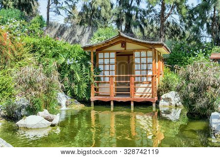Japanese House In Japanese Garden. Natural Landscape.