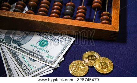Bitcoins On The Background Of Dollars. Golden Bitcoins. Symbolic Coins Of Bitcoin On Banknotes . Exc