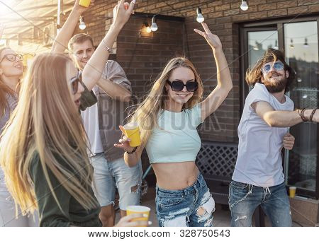 Youngsters Have A Dancing Break During Their Party On A Loft Terrace