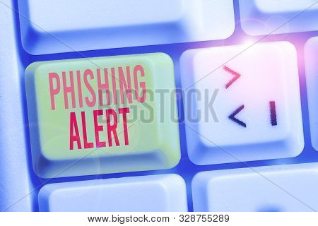 Handwriting text writing Phishing Alert. Concept meaning aware to fraudulent attempt to obtain sensitive information White pc keyboard with empty note paper above white background key copy space. poster