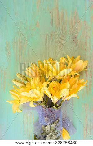 Close Up Of Lily Flowers On The Wooden Background.