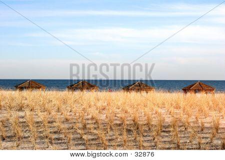 4 beach huts, a sand doon and the ocean. atlantic city nj poster