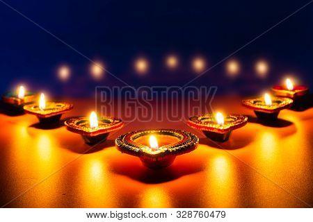 Indian Festival Diwali, Diya Oil Lamps Lit On Colorful Rangoli. Hindu Traditional. Happy Deepavali.