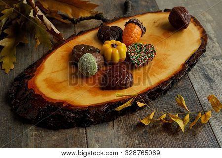Autumn Chocolate Bonbon Decorated With Some Leaves