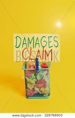 Handwriting text Damages Claim. Concept meaning Deanalysisd Compensation Litigate Insurance File Suit Trash bin crumpled paper clothespin empty reminder office supplies yellow. poster