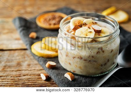 Banana Flax Seeds Overnight Oats With Banana Slices And Almonds