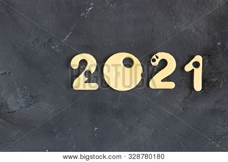 Figures 2021 Made Of Cheese With Holes, On A Black Contrast Chalk Board Background, Symbol Of Proper