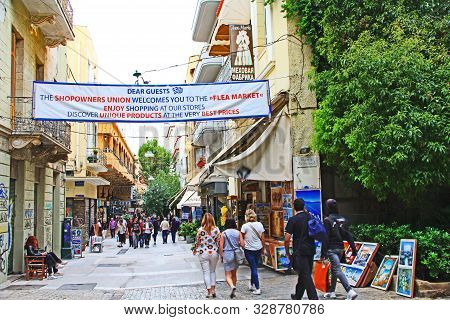 Athens, Attica, Greece - October 17, 2018:  Tourists Walking And Shopping In A Flea Market Along An