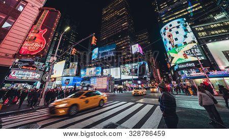 New York City, United States - Apr 4, 2019: Crowded People, Car Traffic Transportation, Billboards A