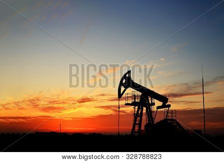 Oil Drilling Derricks At Desert Oilfield. Crude Oil Production From The Ground. Oilfield Services Co