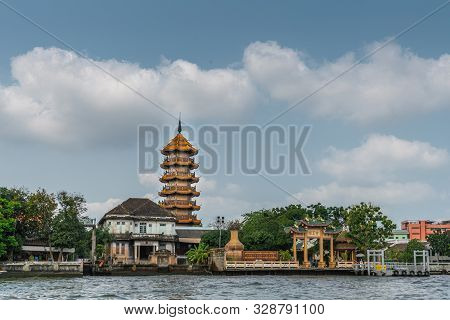 Bangkok City, Thailand - March 17, 2019: Wide View Chao Phraya River. Chee Chin Khor Temple And Red