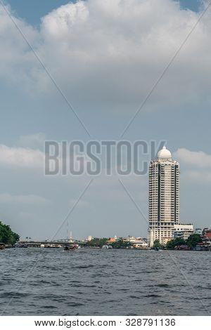 Bangkok City, Thailand - March 17, 2019: Chao Phraya River. White Bangkok River Park Condominium Com