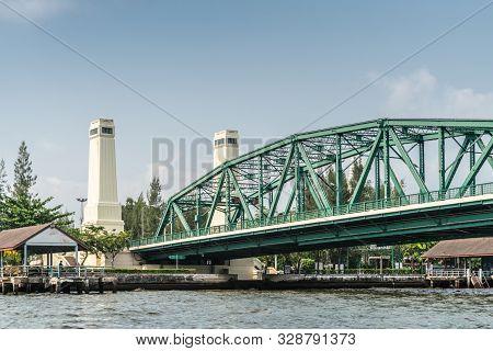 Bangkok City, Thailand - March 17, 2019: Green Metal Memorial Bridge Over Chao Phraya River, With It