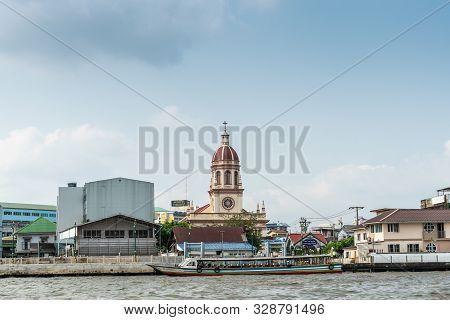 Bangkok City, Thailand - March 17, 2019: Chao Phraya River. Red Domed Beige Tower Of Santa Cruz Cath
