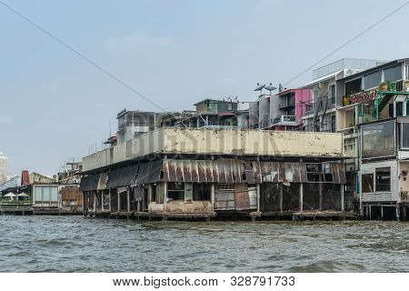 Bangkok City, Thailand - March 17, 2019: Chao Phraya River. Run-down And Half Demolished Warehouse A