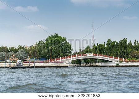 Bangkok City, Thailand - March 17, 2019: Chao Phraya River. White River With Maroon Protective Board