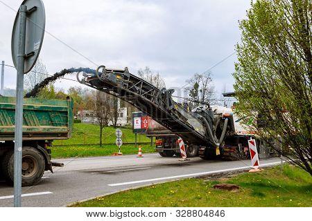 Valasske Mezirici, Czech Republic, 23 April 2019: Road Repair. Milling Machine Removes Old Asphalt F