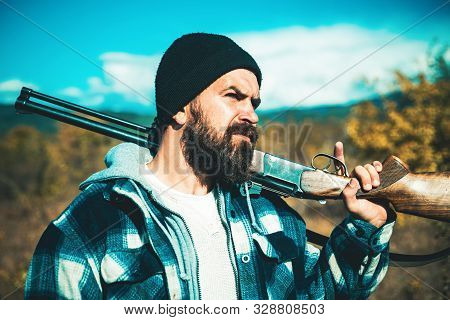 Hunter Man. Hunting Period, Autumn Season. Hunter With A Hunting Gun And Hunting Form To Hunt In For