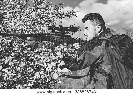 Hunting In Spring Forest. Hunter With Shotgun Gun On Hunt. Hunter Moving With Shotgun Looking For Pr