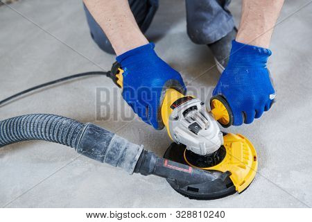 concrete floor surface grinding by angle grinder machine