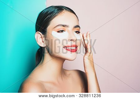 Moisturizing Eye Patches. Taking Care Of Her Skin. Woman Using Eye Patches Spending Time At Home. Da