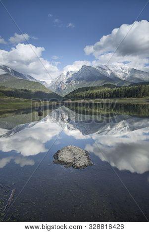 Calm Water And Rock In A Montana Reservoir Near St. Ignatius, Montana