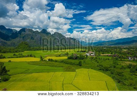Aerial View Of Green Rice Fields And Mountains, Paddy Field At Vang Vieng , Laos. Southeast Asia. Ph