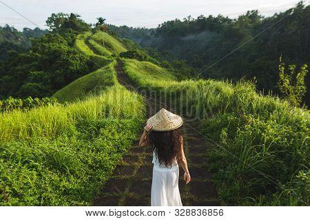 Young Beautiful Woman Walking On Campuhan Ridge Way Of Artists, In Bali, Ubud. Beautiful Calm Sunny