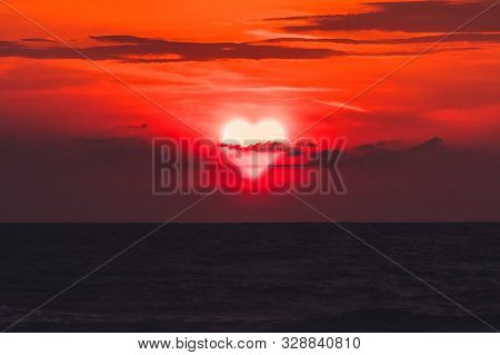 Cloud Heart. Heart Walks Off Into The Sunset Over The Sea In Dark Clouds. Past Love. Separation. Con