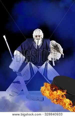 Hockey Goalie Stands In Blue Smoke Ready To Catch Fiery Puck.hockey Goalie In Complete Hockey Gear