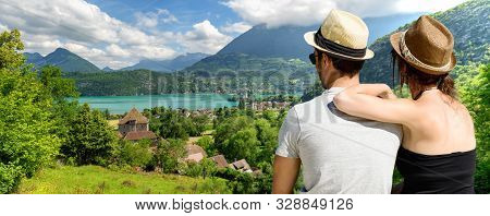 A Young Lovers Couple Watching Lake Of Annecy. France